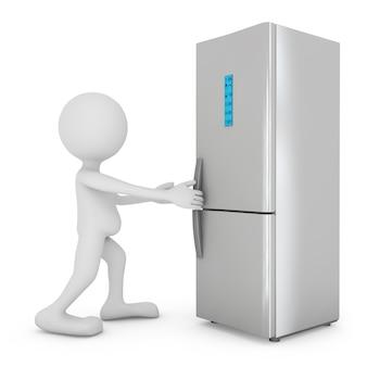 L'homme ouvre le réfrigérateur