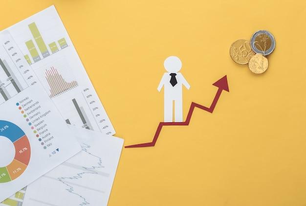 Homme de papier avec flèche de croissance, graphiques et tableaux. symbole de réussite financière et sociale, escalier vers le progrès.