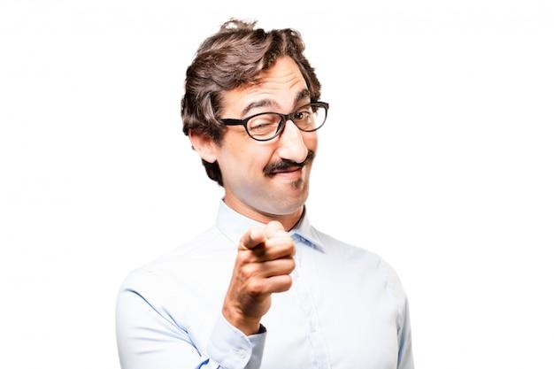 L'homme Pointant Avec Des Lunettes Photo gratuit