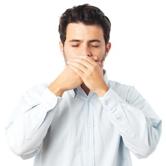 Homme silencieux geste sur fond blanc