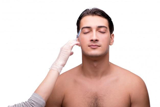 Homme subissant une chirurgie plastique isolée on white
