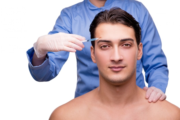 Homme subissant une chirurgie plastique isolée on white