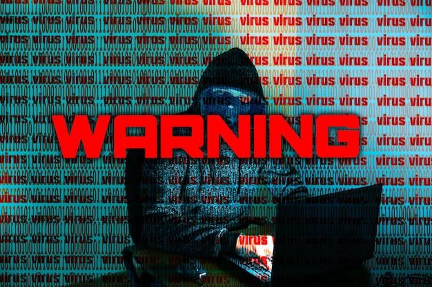 L'homme en sweat à capuche pirate des données personnelles. sécurité des informations. concept de virus d'avertissement. protection des informations. mauvais mot de passe.