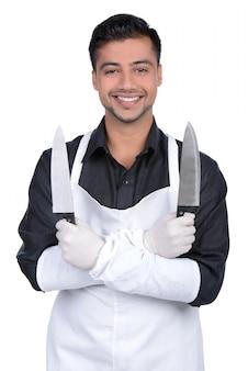 Homme, tablier, tenant couteau, mains
