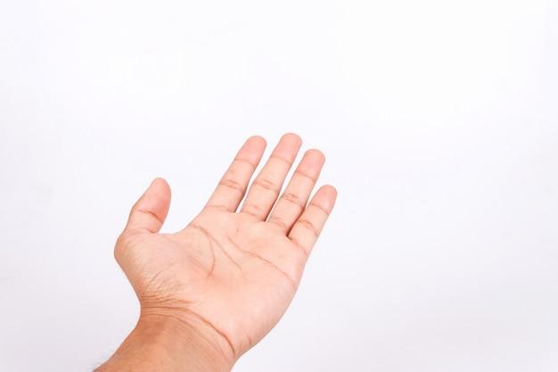 Homme teen main pour tenir le gadget, isolé sur fond blanc