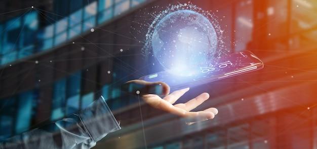 Homme tenant un globe terrestre de données sur un smartphone