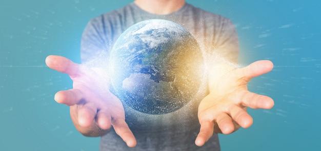 Homme tenant un globe terrestre de particules