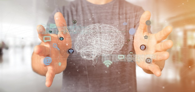 Homme tenant une intelligence artificielle avec un cerveau et une application