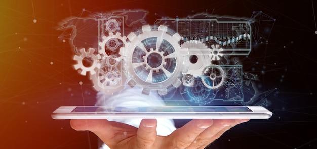Homme tenant une interface de roue dentée de technologie