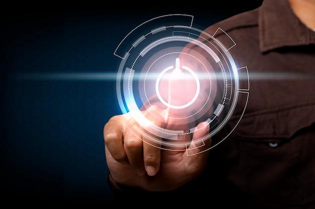 Homme touchant l'écran, appuyant sur un bouton d'alimentation de l'écran tactile. innovation conceptuelle.