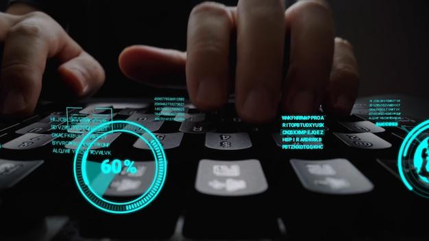 Homme travaillant sur un clavier d'ordinateur portable avec interface utilisateur graphique
