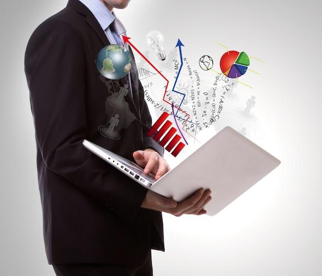 L'homme utilisant un ordinateur portable graphiques émergents