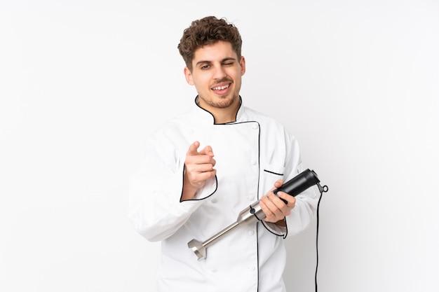 Homme, utilisation, mélangeur main, sur, mur blanc, points, doigt
