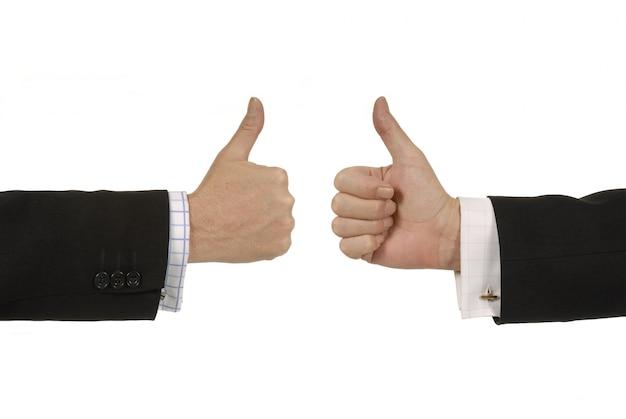 Les hommes d'affaires donnant pouces vers le haut signe