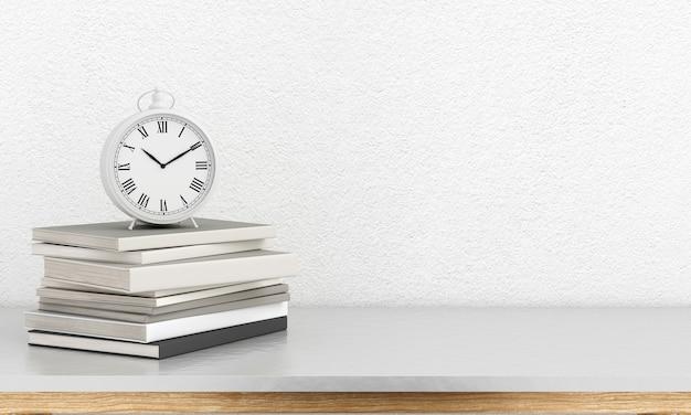 Horloge sur le livre sur la table dans la salle blanche