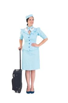Hôtesse de l'air jolie tenue valise