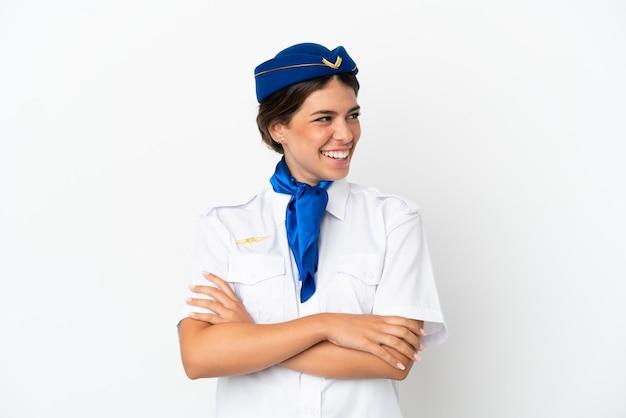 Hôtesse d'avion femme caucasienne isolée sur fond blanc heureux et souriant