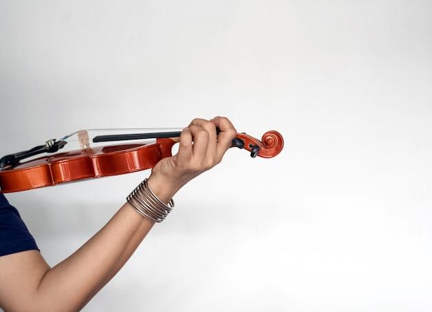 Human hand holding violin