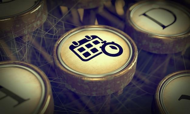 Icône de gestion du temps sur le bouton de la vieille machine à écrire