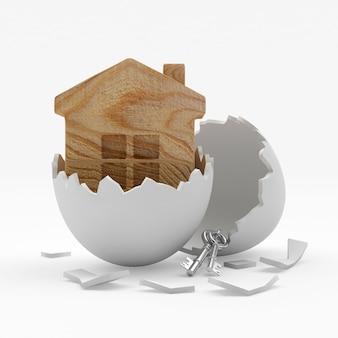 Icône de maison en bois dans une coquille d'oeuf cassée