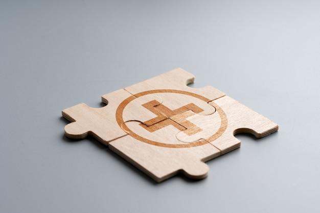 Icône médicale sur puzzle pour les soins de santé mondiaux