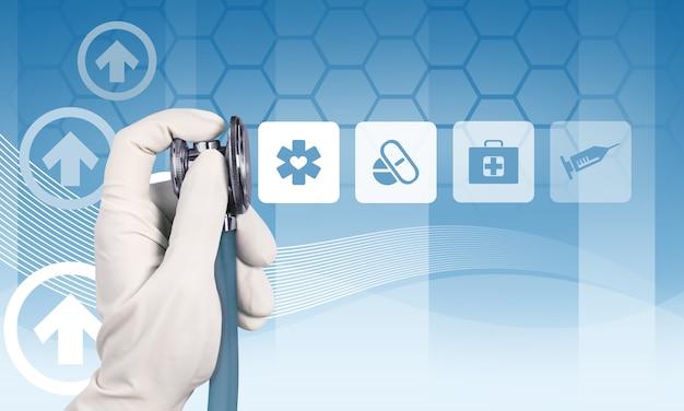 Icônes médicales et main dans un gant médical tenant un stéthoscope sur fond bleu