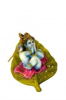 Idole d'argile colorée de lord krishna