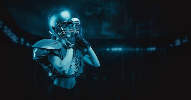 Iimage d'une fille au stade dans l'uniforme d'un joueur de l'équipe de football américain. notion de sport. technique mixte