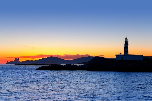 Ile de ibiza au coucher du soleil, phare de freus et es vedra