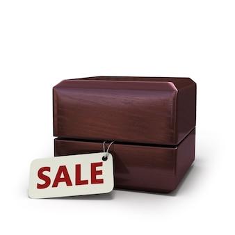 Illustration 3d d'une boîte-cadeau fermée pour bagues et furtivement hors de sa tablette avec une vente d'inscription