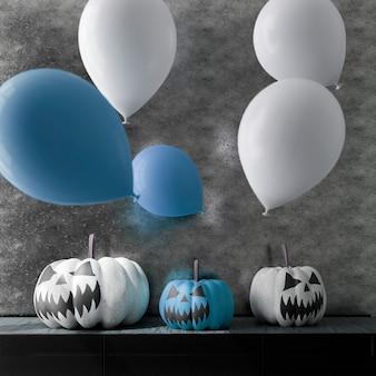 Illustration 3d de la décoration d'halloween de salon. citrouilles et ballons. rendu 3d