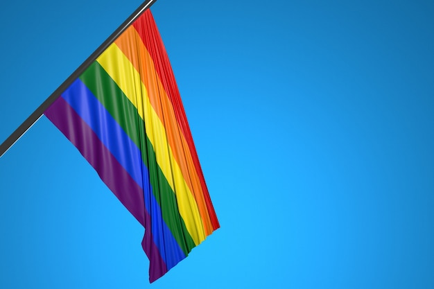 Illustration du drapeau des lgbt sur un mât en métal flottant contre le ciel bleu