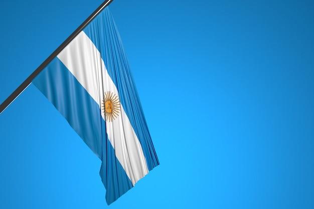 Illustration du drapeau national de l'argentine sur un mât en métal flottant contre le ciel bleu