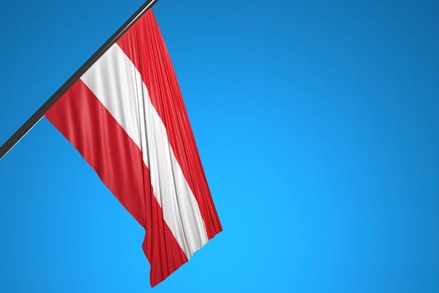Illustration du drapeau national de l'autriche sur un mât en métal flottant contre le ciel bleu