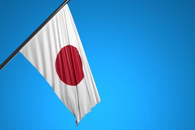 Illustration du drapeau national du japon sur un mât en métal flottant contre le ciel bleu