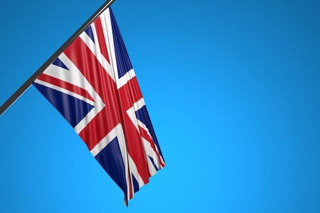 Illustration du drapeau national du royaume-uni sur un mât en métal flottant contre le ciel bleu