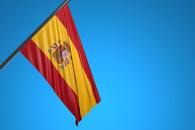 D illustration du drapeau national de l'espagne sur un mât en métal flottant contre le ciel bleu
