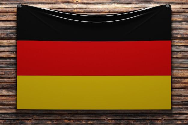 Illustration du drapeau national en tissu de l'allemagne cloué sur un mur en bois
