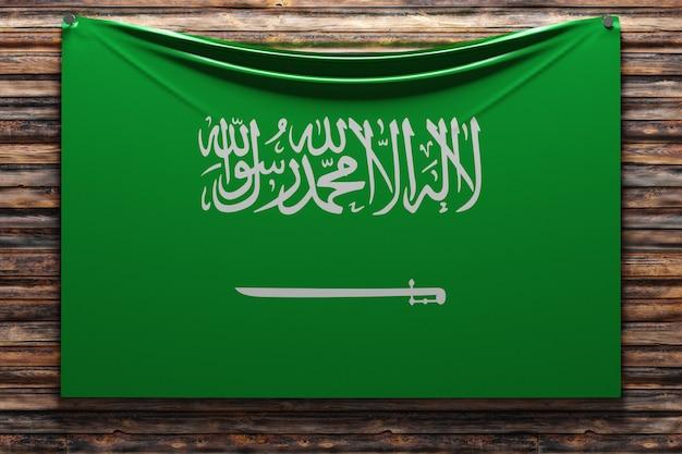 Illustration du drapeau national en tissu de l'arabie saoudite cloué sur un mur en bois