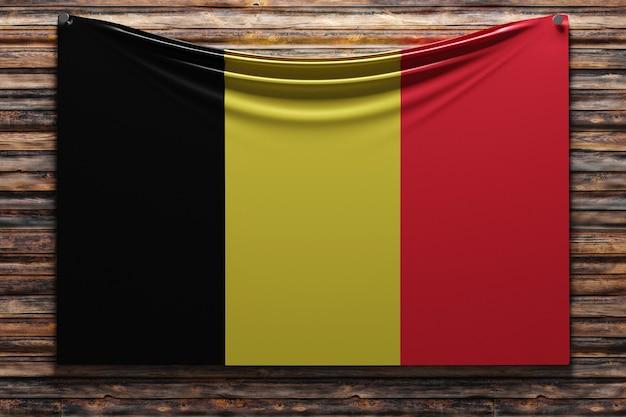 Illustration du drapeau national en tissu de la belgique cloué sur un mur en bois
