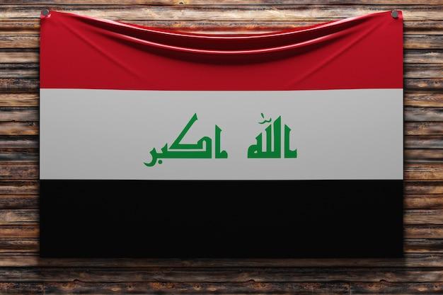 Illustration du drapeau national en tissu de l'irak cloué sur un mur en bois