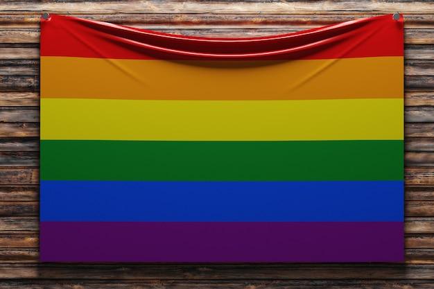 Illustration du drapeau national en tissu des lgbt cloué sur un mur en bois