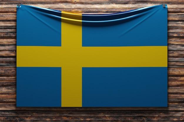 Illustration du drapeau national en tissu de la suède cloué sur un mur en bois