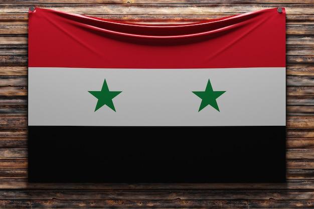 Illustration du drapeau en tissu national de la syrie cloué sur un mur en bois