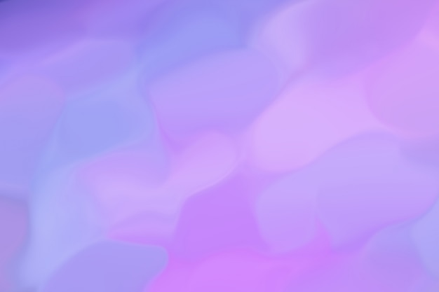 Cette image abstraite scintille de couleurs différentes, du bleu au rose au lilas. motif flou. outremer combiné avec des néons. style rétro années 80