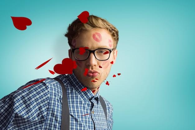 Image composite de hipster geek couvert de baisers