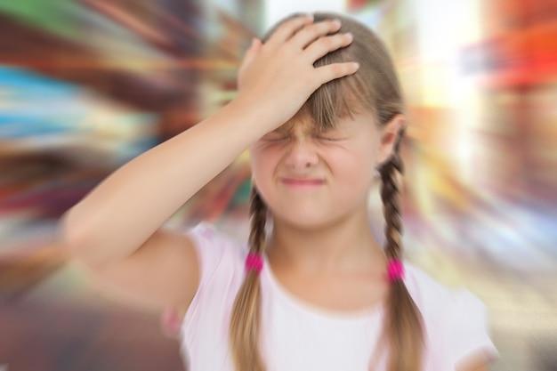Image composite de petite fille avec maux de tête