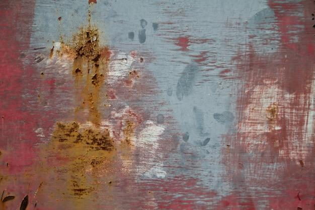 Image de fond de mur rouge et bleu avec des marques de rouille
