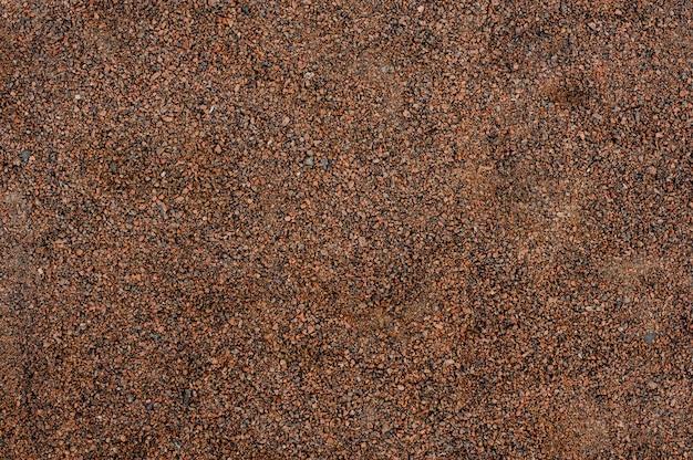 Image de fond des petits cailloux bruns, rouges et gris