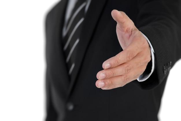 Image gros plan de l'homme d'affaires, serrer la main avec vous.